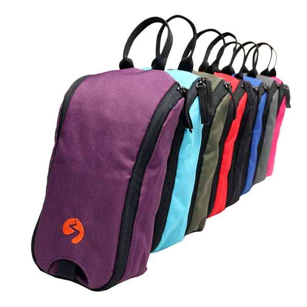 Group photo of small toiletries bag in multiple colors.