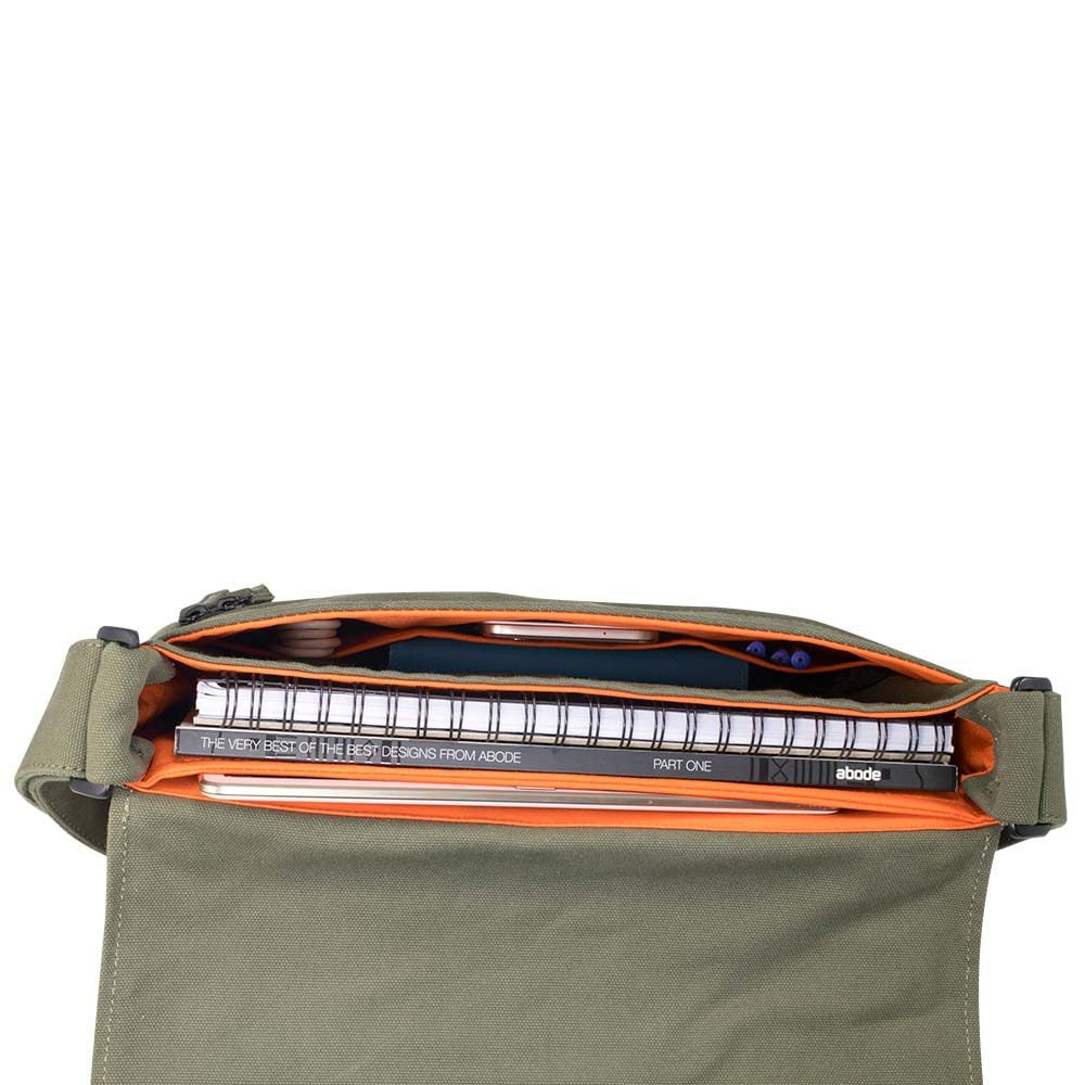 "Top down photo in studio of 13"" Olive green canvas satchel bag showing various accessories"