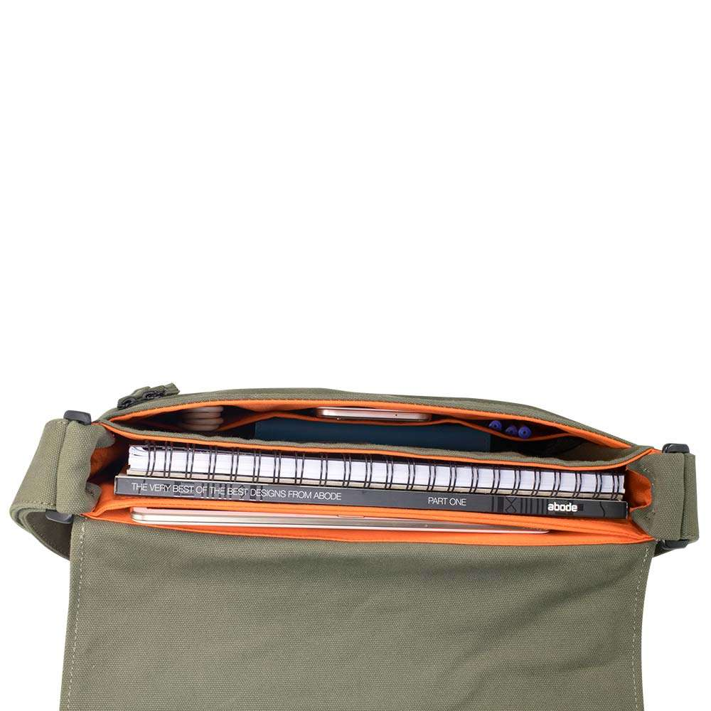 """Top down photo in studio of 13"""" Olive green canvas satchel bag showing various accessories"""